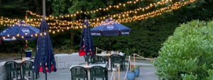 Outdoor dining with string lights